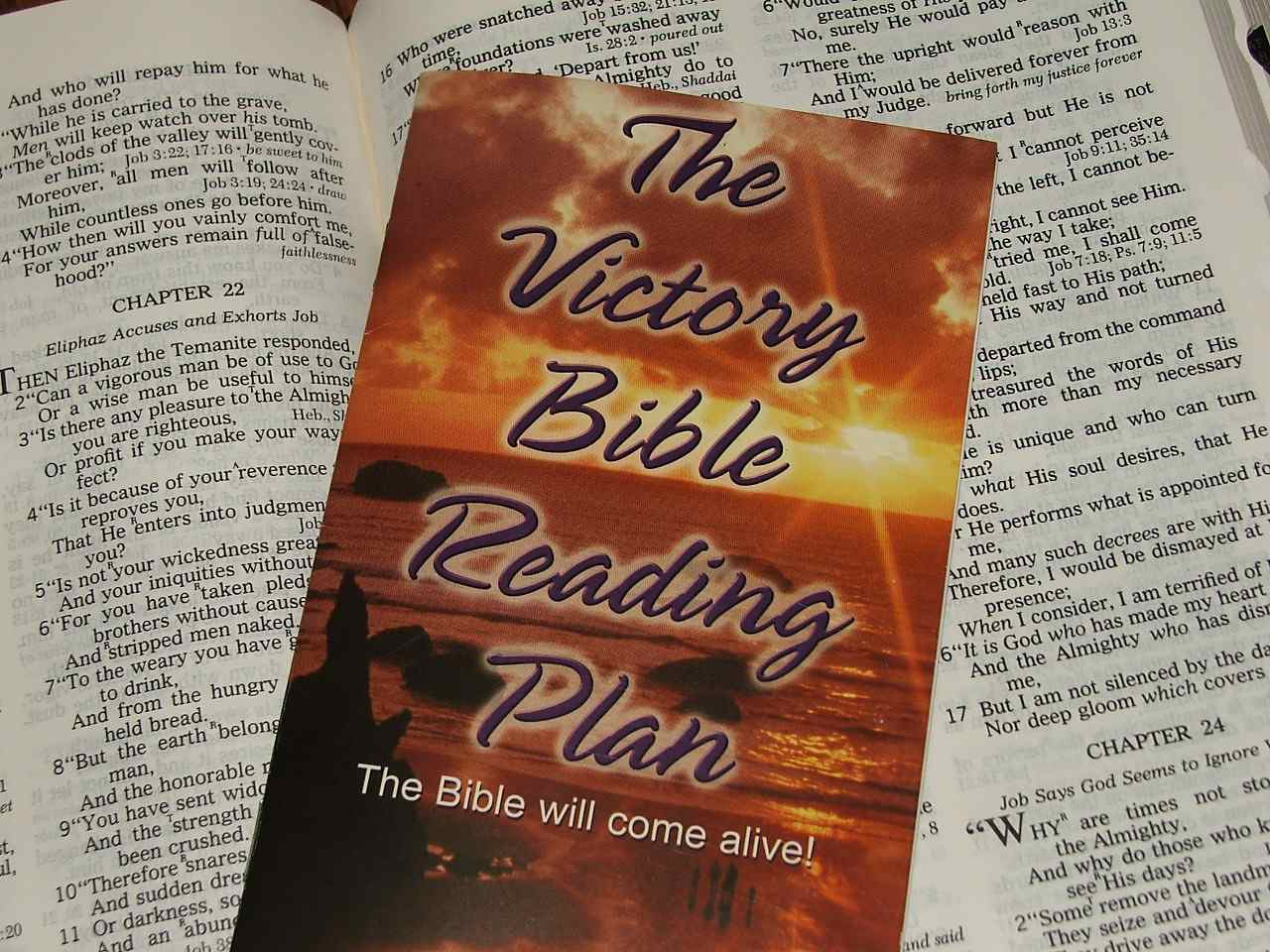 A Bible pamphlet sitting on a Bible.