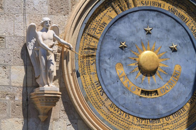 Angel next to model of solar calendar, Italy, Sicilia, Messina