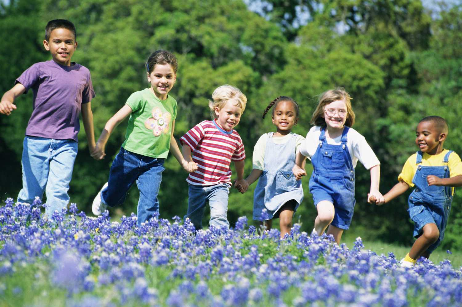 Kids Playing Outside in Flowers