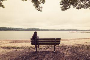 Girl Meditating on a Bench
