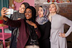 Muslim women taking a selfie