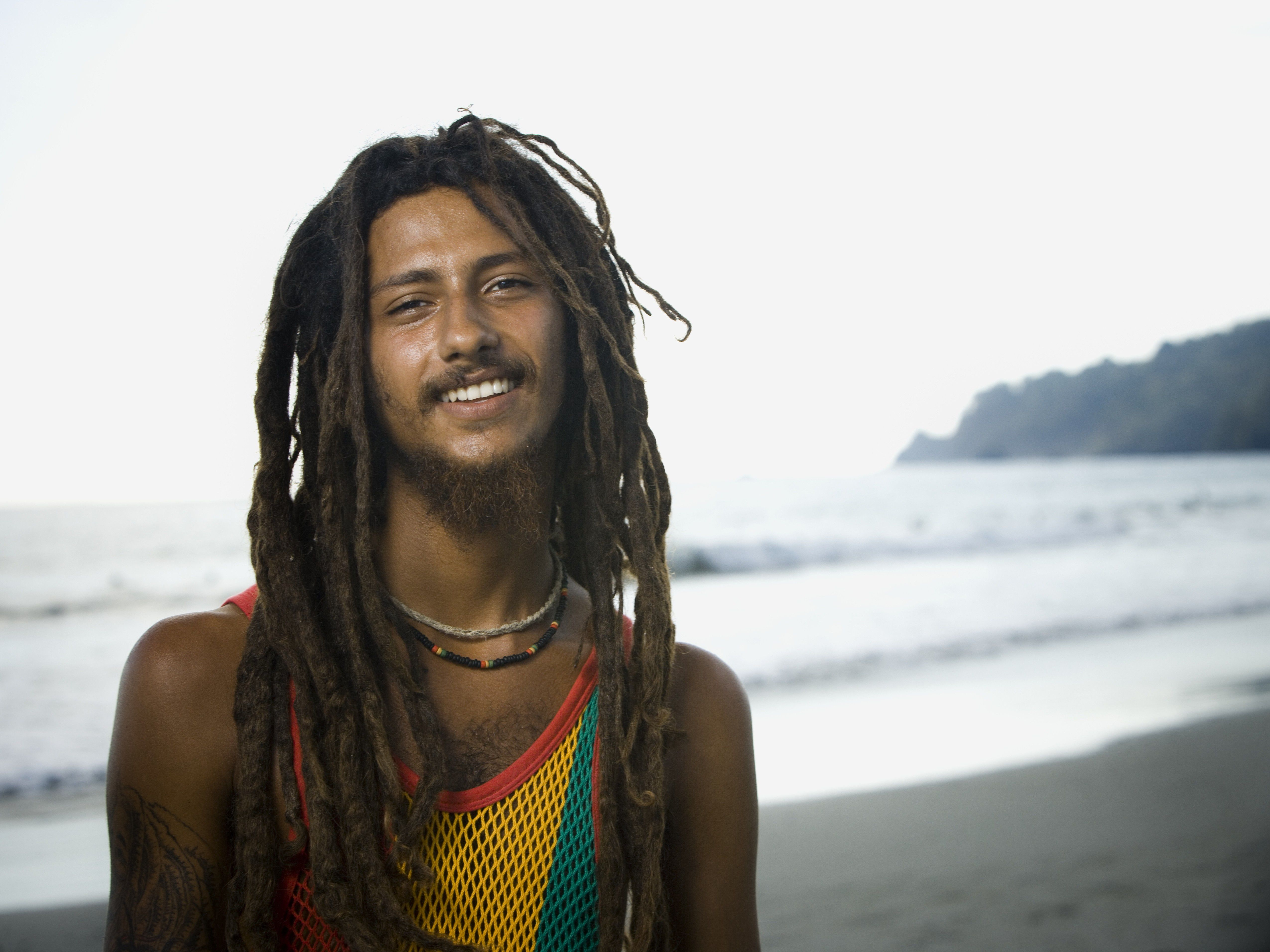 Portrait of a young man smiling on beach.