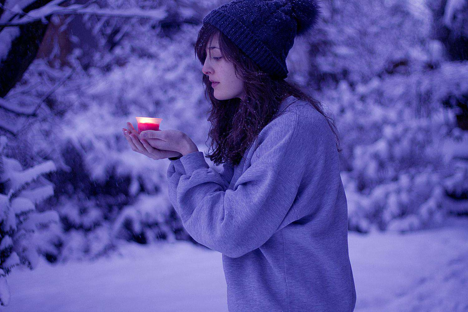 Woman with Candle in Snow