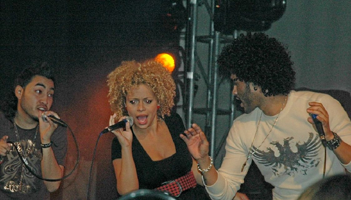 The members of Group 1 Crew performing on stage.