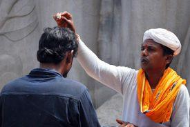 Hindu priest giving blessing in Belur, Karnataka.