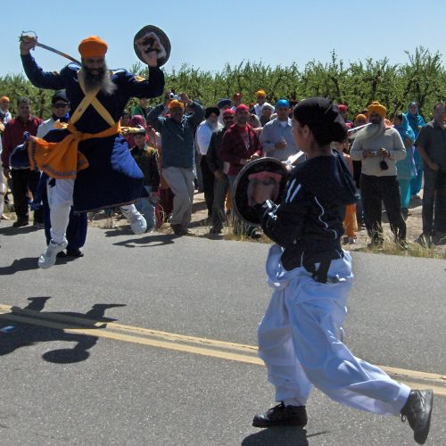 Gatka Student and Master Demonstrate Skill with Swords During Hola Mohalla