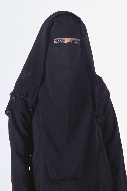 A woman wearing an abaya, hijab, and niqab.
