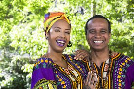 Portrait of laughing young woman and her father wearing traditional Brazilian clothing