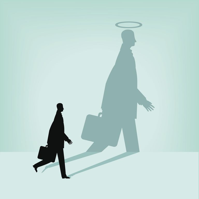 shadow of man with briefcase as angel