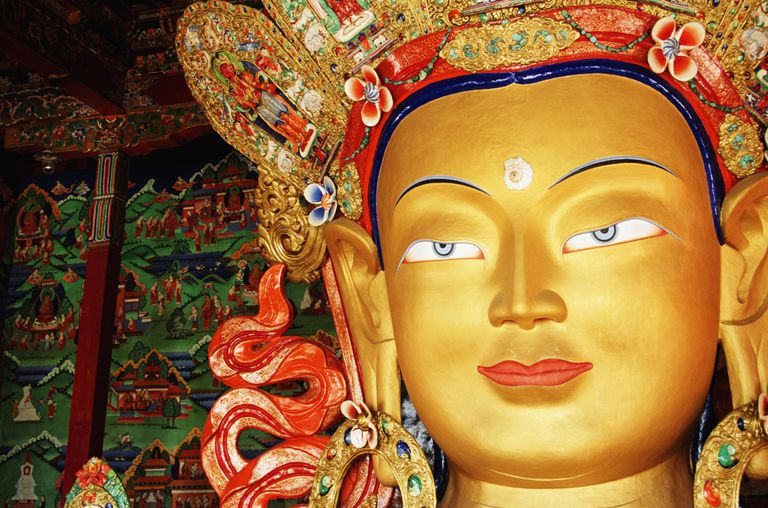 A golden statue of Maitreya in India