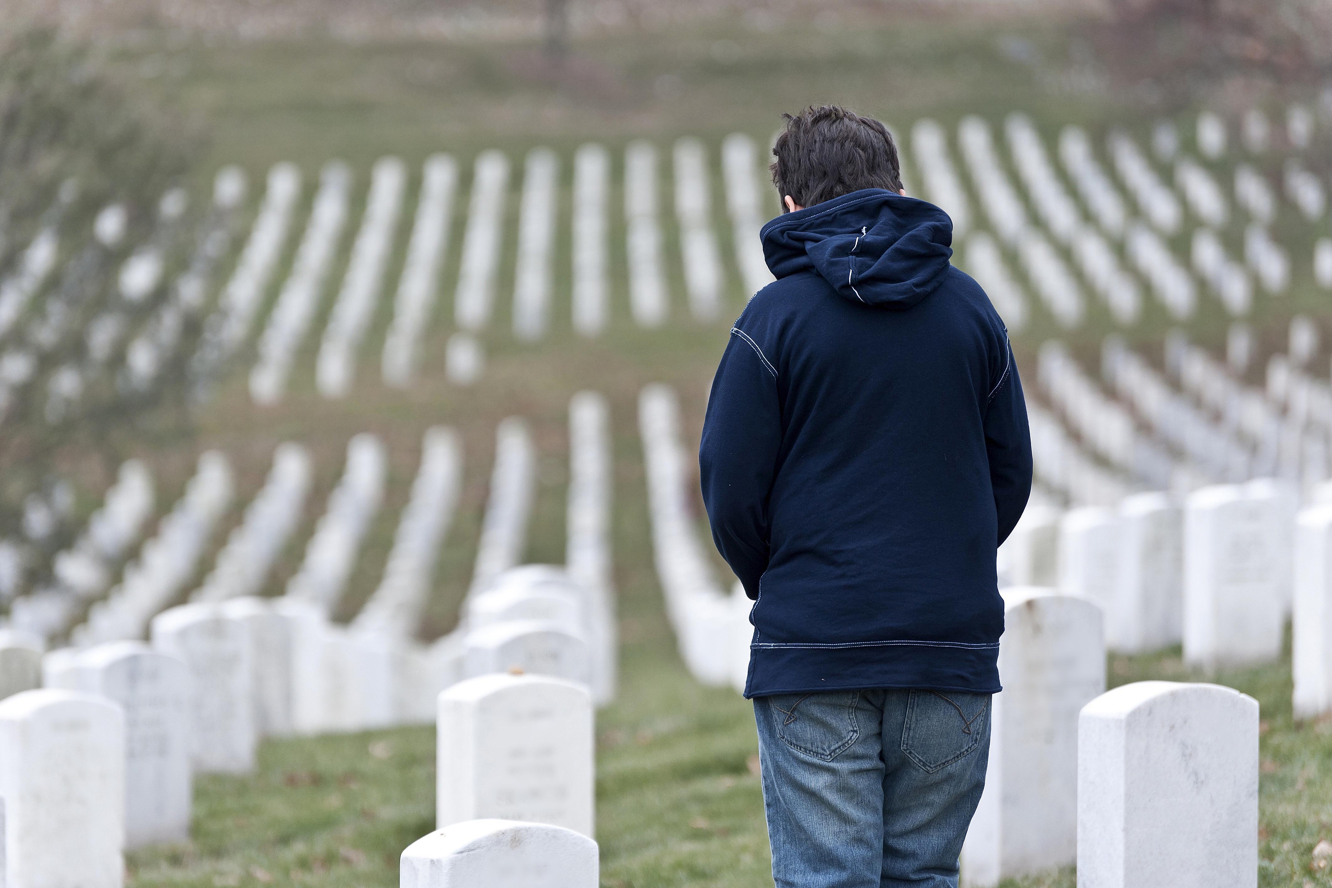 A boy in a cemetery.