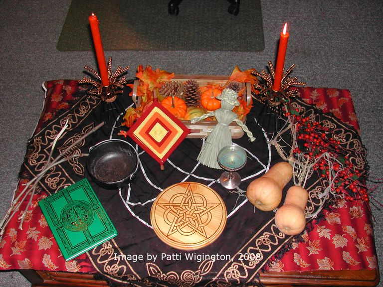 Decorate your Mabon altar with symbols of the season.