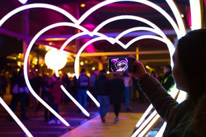 people walk through heart lights