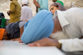 Pilgrims bow to the Guru Granth Sahib