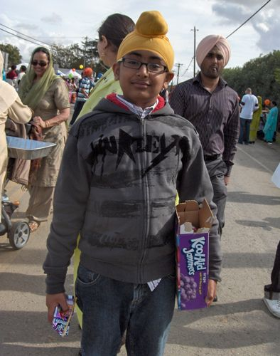 Sikh Child Giving Out Free Beverages Along Yuba City Parade Route