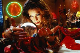 Psychic Reader Peers Into Crystal Ball