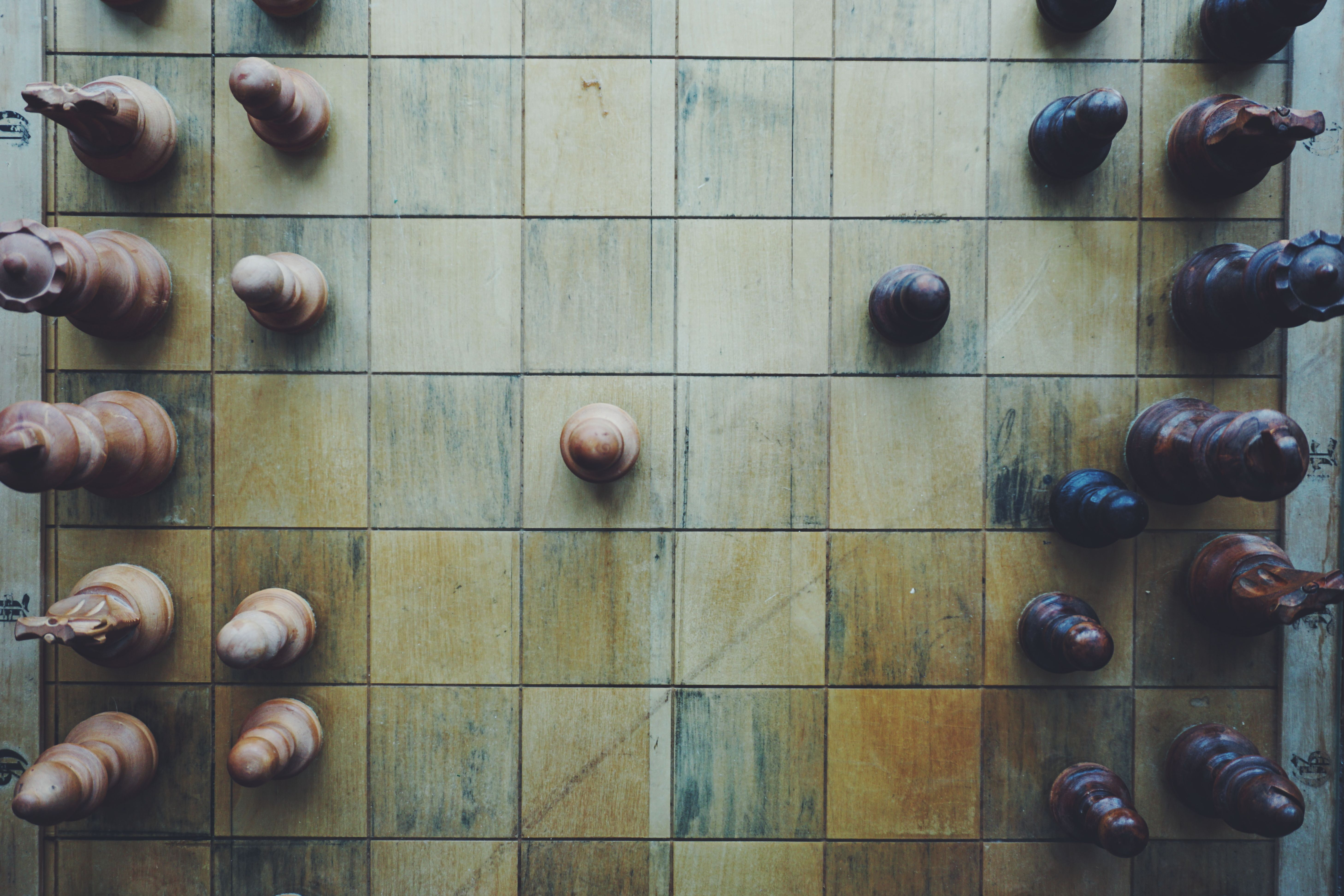 Sky-view of wooden chess board with pieces