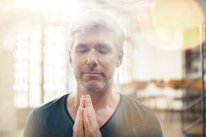 Close up of man meditating.