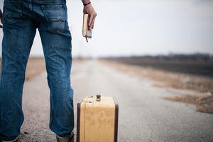 man standing on empty road