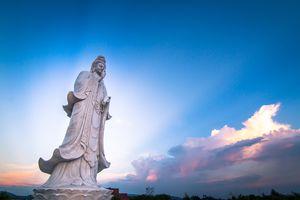 Buddha statue before blue sky sunset