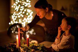 Woman lighting candle