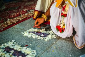 Low Section Of Couple Performing Rituals During Wedding Ceremony