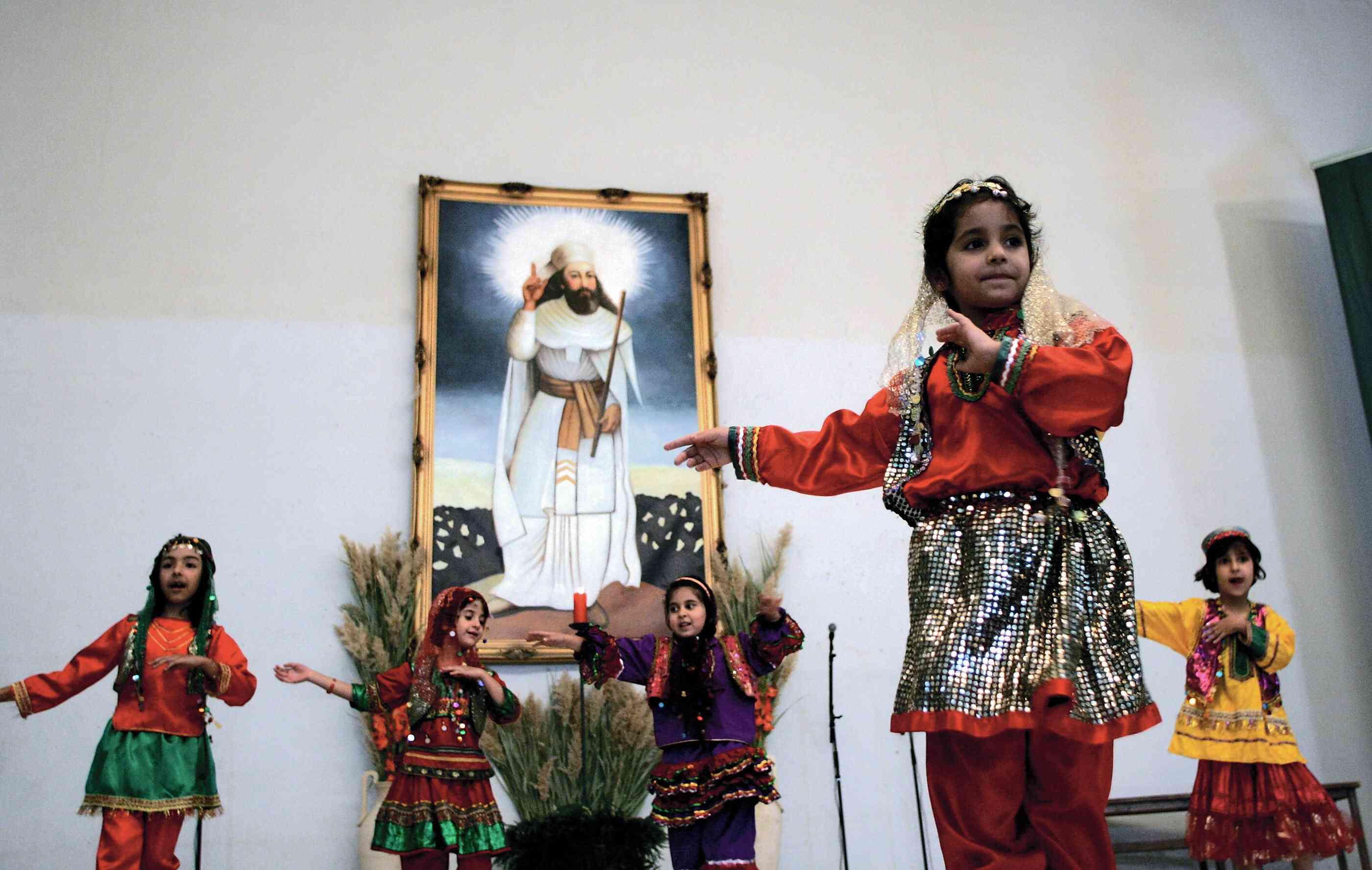 Iranian Zoroastrian girls perform a traditional dance
