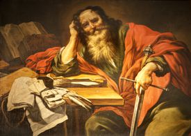 The apostle Paul holding a sword, leaning on epistles
