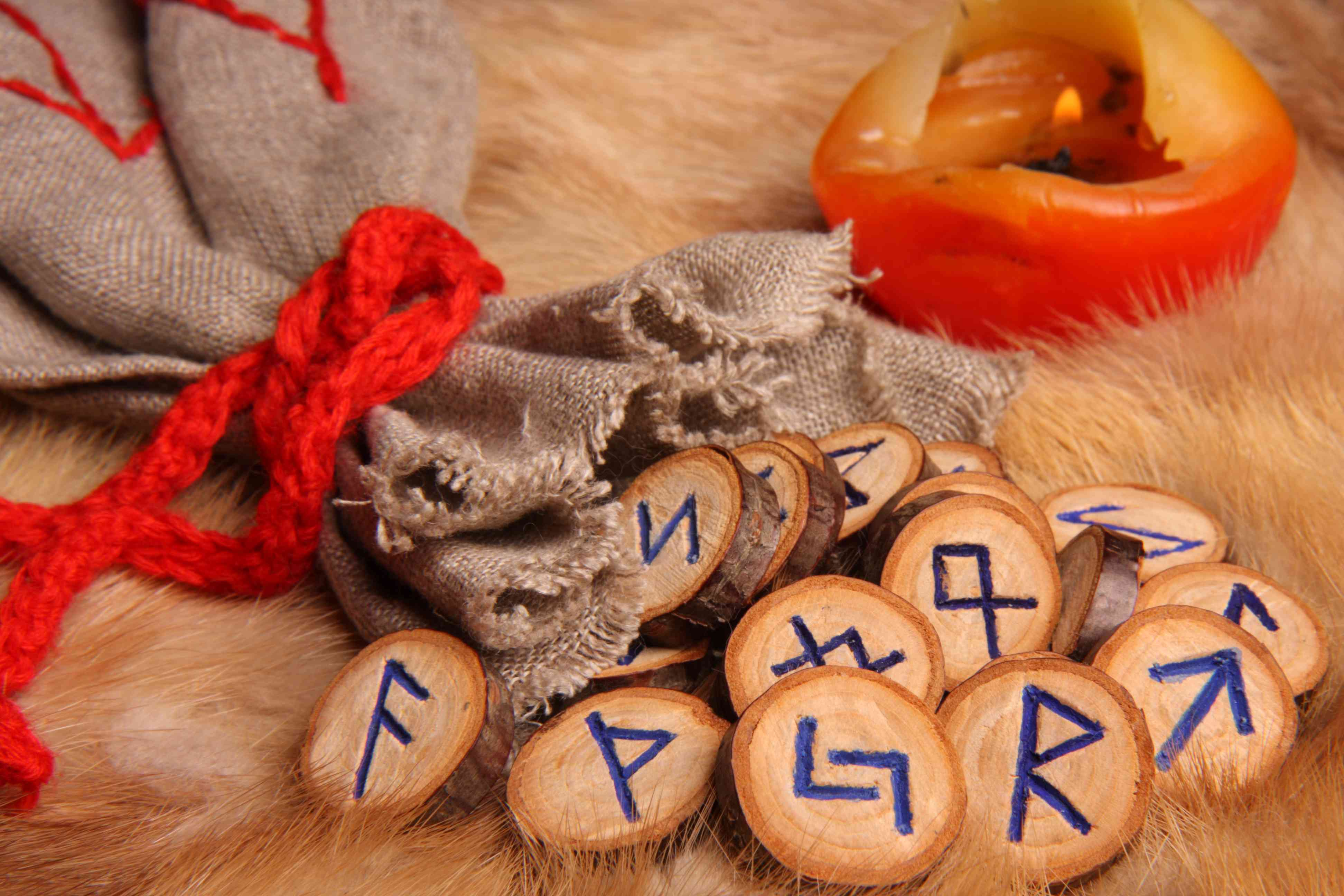 Runes with pouch and candle