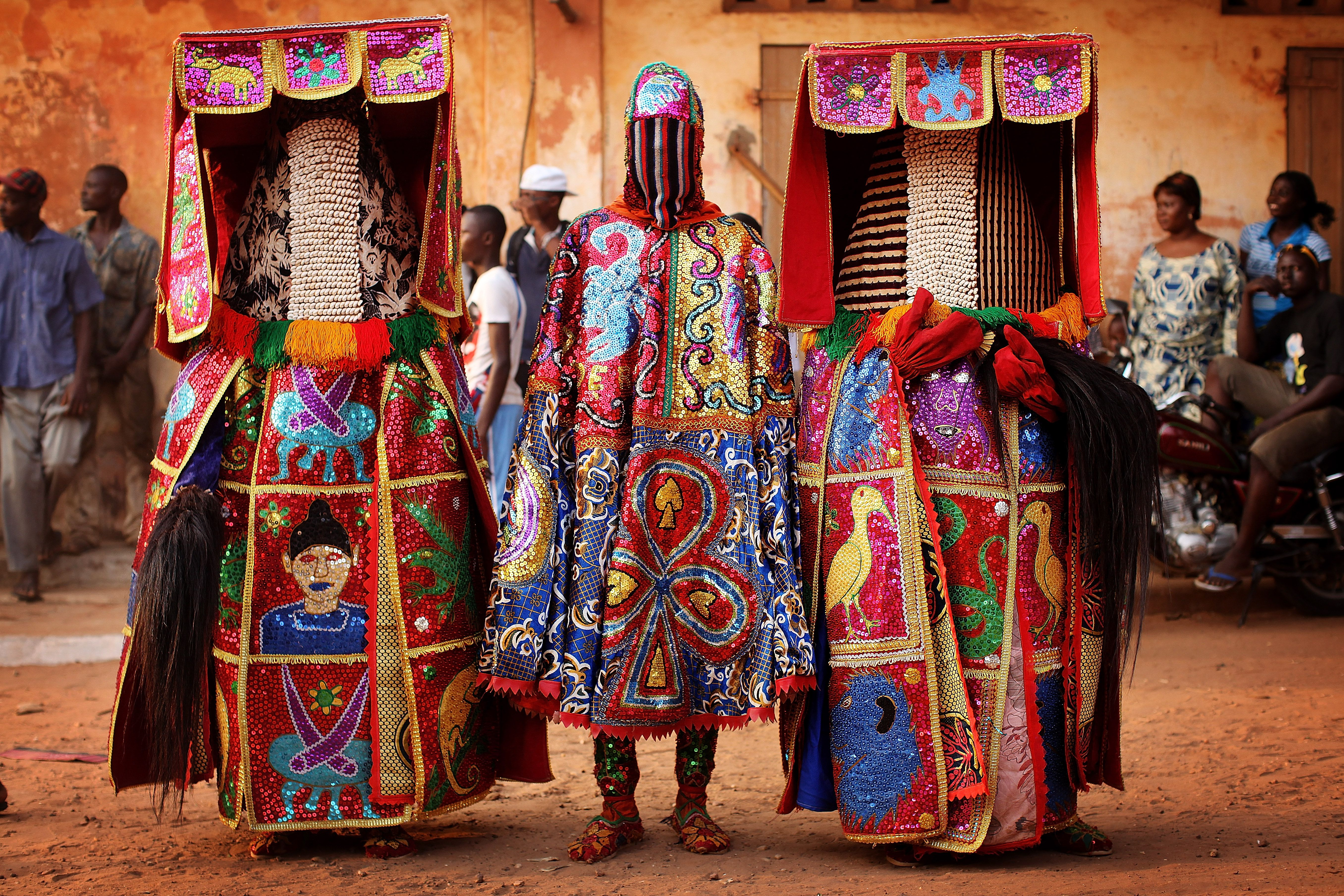 People dressed in ceremonial clothing at Annual Vodou Festival.