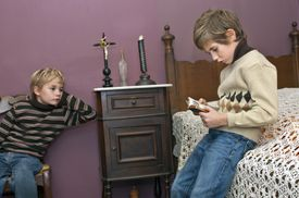 Child who reads the Bible to his brother