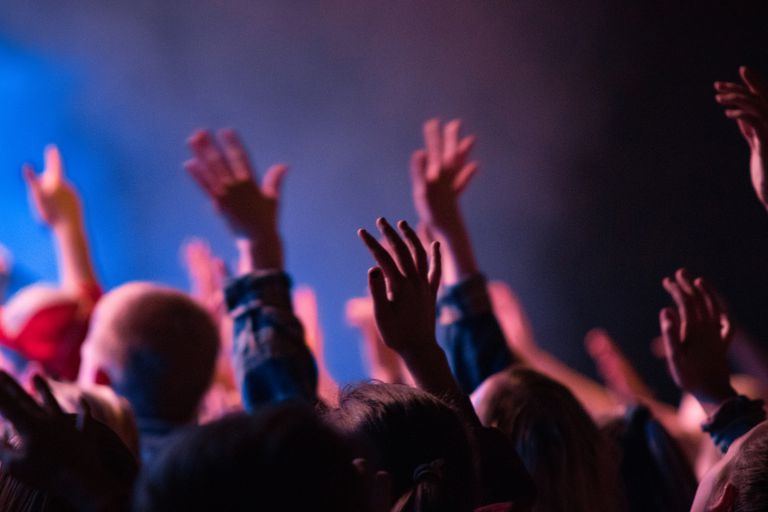 People raising their hands in worship