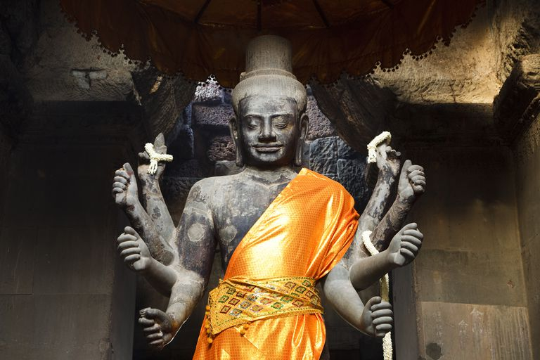 Robed statue of Vishnu in West Portico, at the main entrance to Angkor Wat.