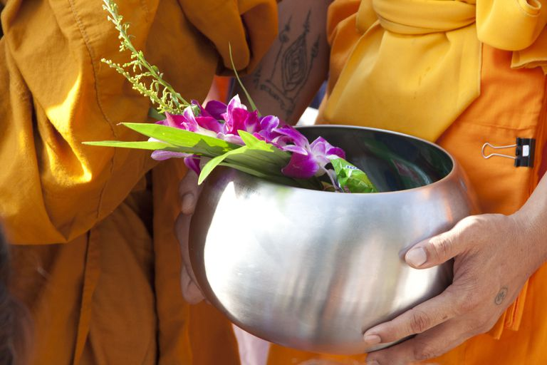Monks holding alms bowl.