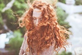 Redhaired woman outdoors in spring