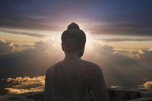 Buddha statue and the Sun