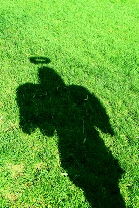 angel shadow on grass ground