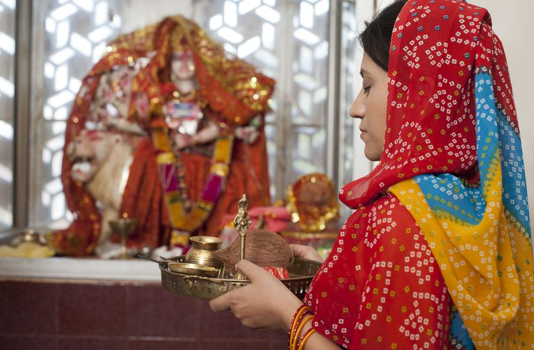 woman praying to Hindu god
