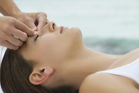 Woman receiving an acupressure massage