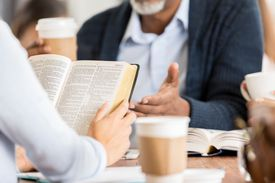 People discussing the bible