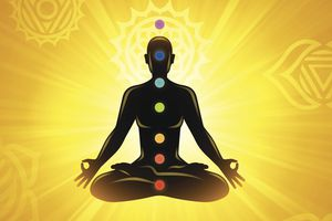 Silhouette of Meditator with Chakra Points