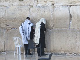 Rear View Of Men Standing At Wailing Wall