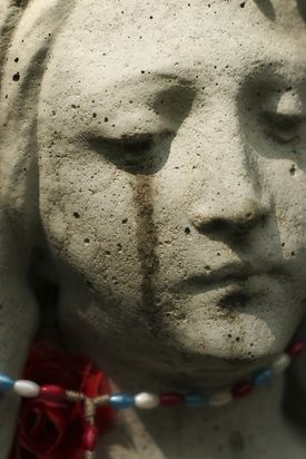 Virgin Mary statue crying tears