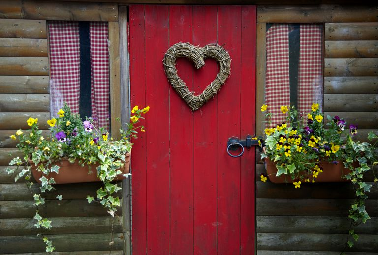 A heart on a red cottage door
