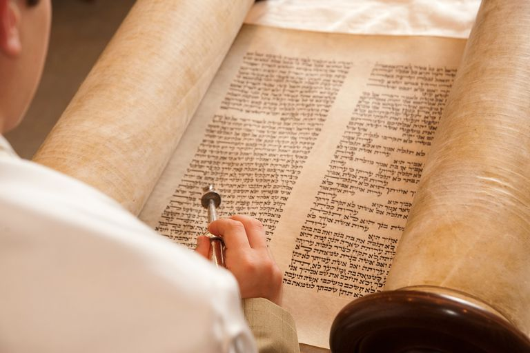 Boy reading from Torah scroll