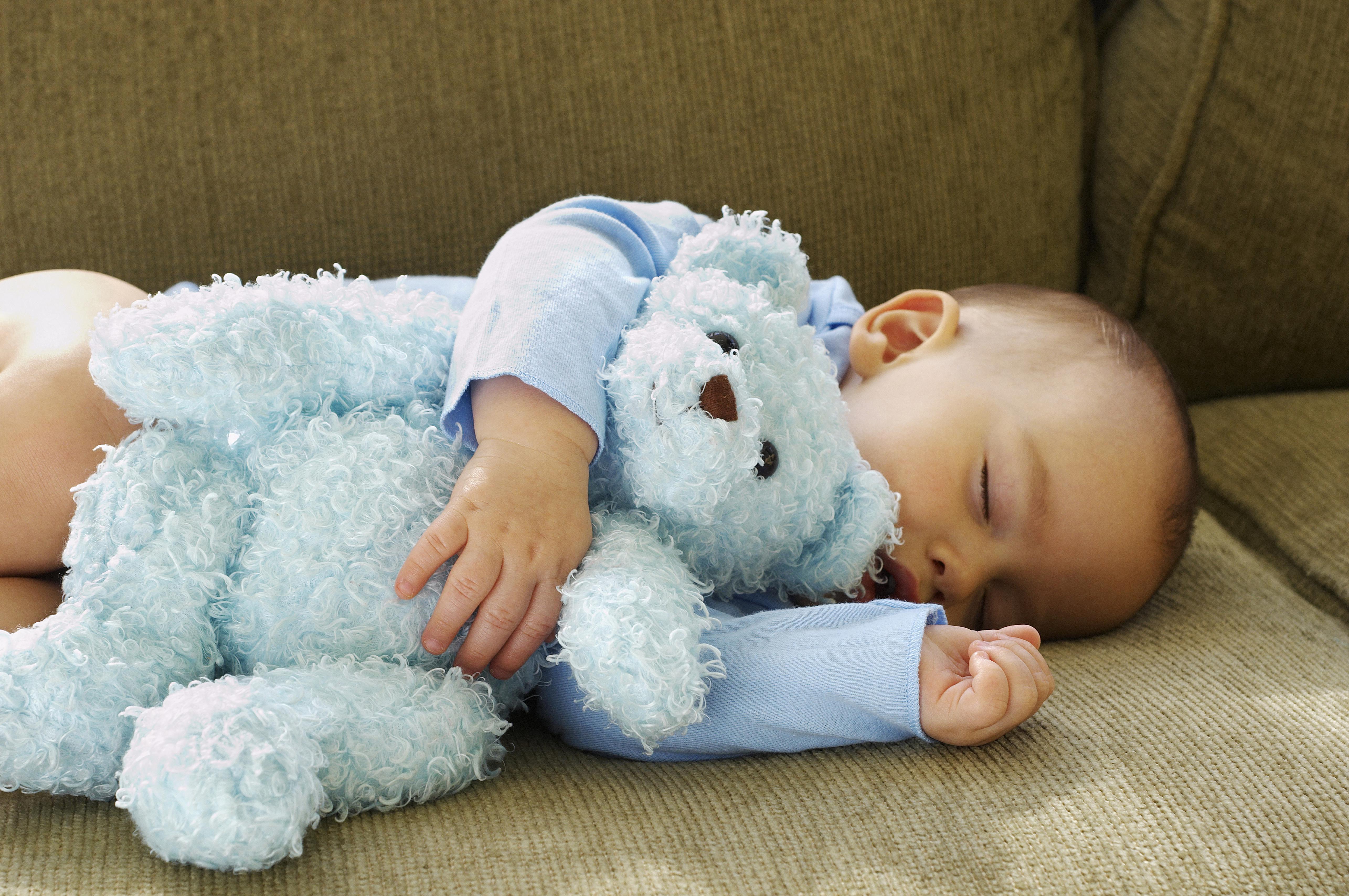 Baby Boy Sleeping with Teddy Bear