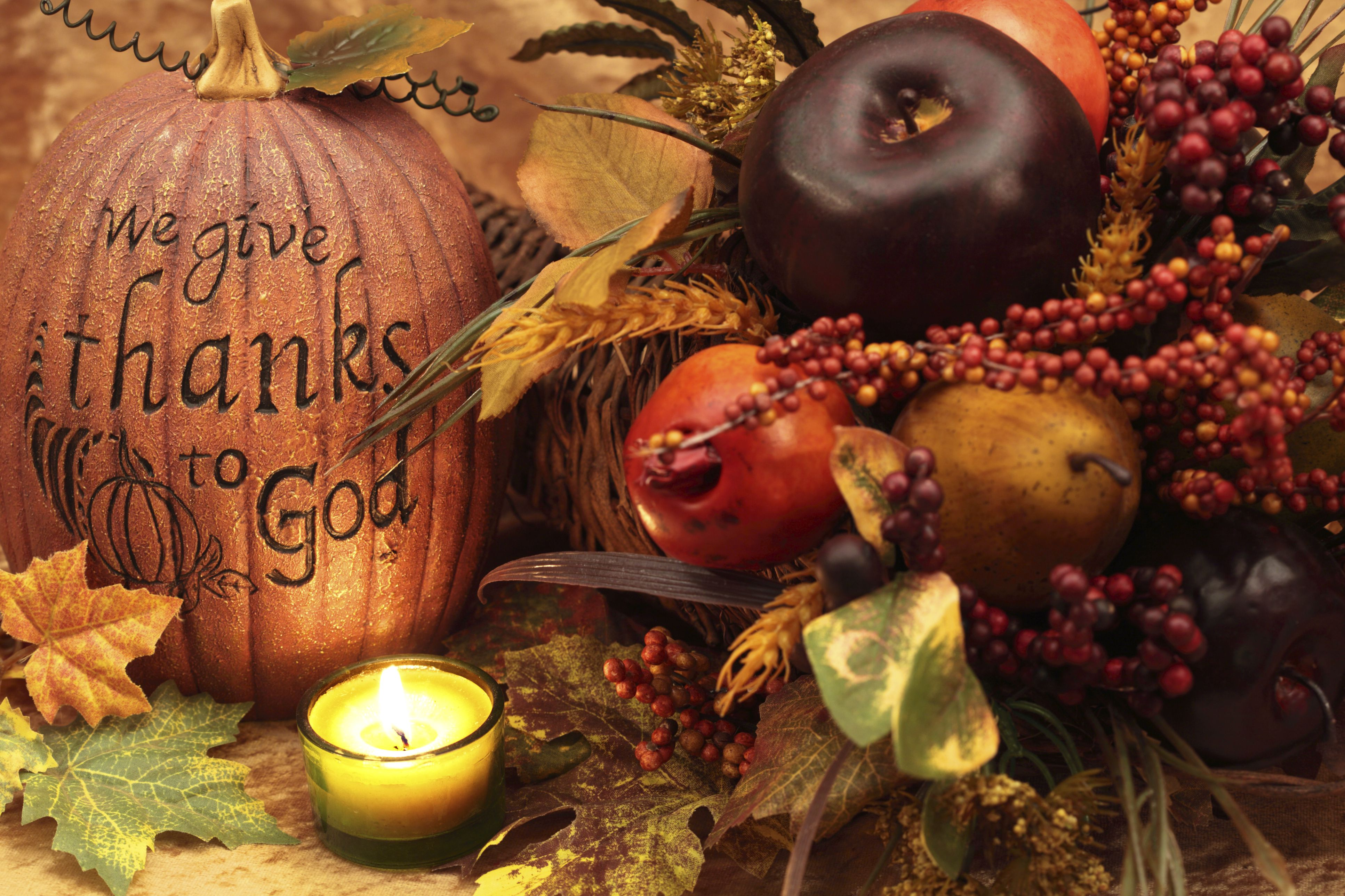 """Table setting with pumpkin with """"we give thanks to God"""" carved into it"""