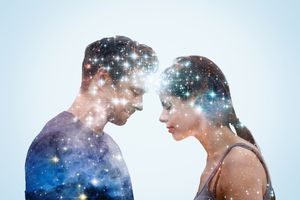 Couple leaning into each other with stars.
