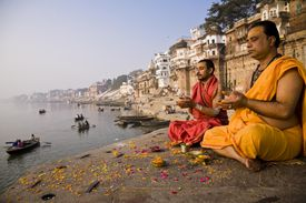 Brahmin priest and assistant in prayer