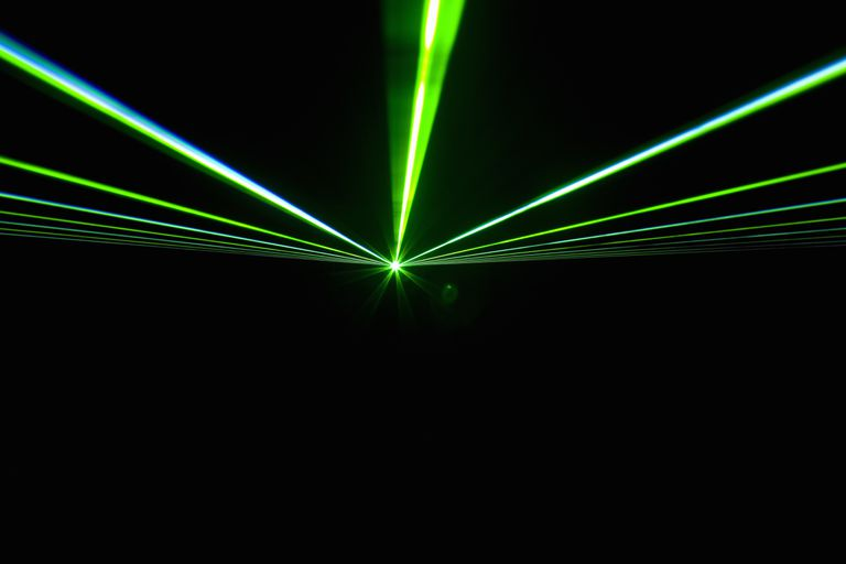 Green rays of light on a black background